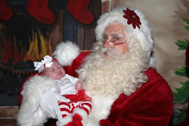 Baby's first picture with Santa Claus