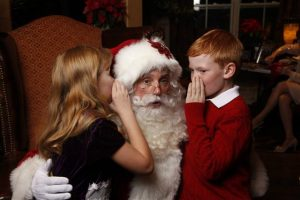 children whispering santa